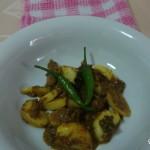 Garlic curry (Garlic kalu pol maluwa)