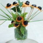 A bunch of flowers with a carrot